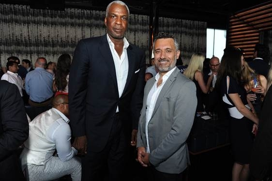 Selman Yalcin with Charles Oakley is a former American professional basketball player.