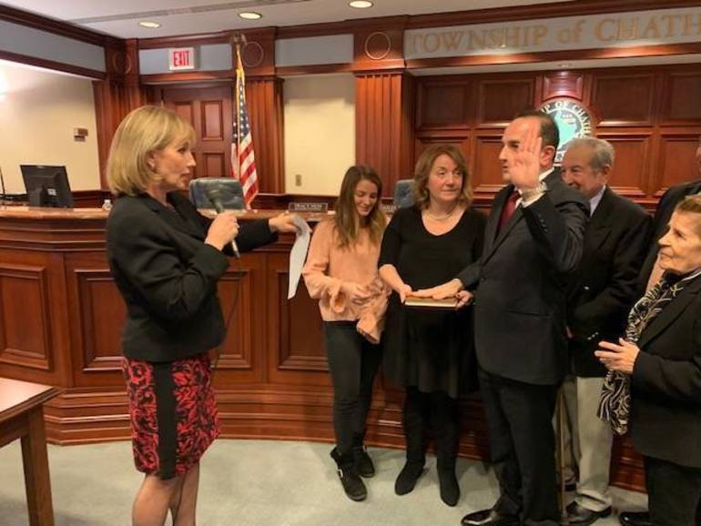 Tayfun Selen takes the oath of office as Chatnam Township Mayor with former Lt Governor Kim Guadagno doing the honors. Credit:TAP Chatnam