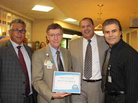 Bob Bucciarelli, vice president of Sodexo, from left; Dr. Allen Weiss, president and chief executive officer of the NCH Healthcare System; Carlos Noriega, regional director of Sodexo; and Lee Almeida, retail and catering manager for NCH.