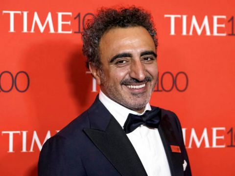 FILE - In this April 25, 2017 file photo, yogurt mogul Hamdi Ulukaya attends the TIME 100 Gala, celebrating the 100 most influential people in the world, at Frederick P. Rose Hall, Jazz at Lincoln Center in New York. As Chobani turns 10, Ulukaya talked to The Associated Press about yogurt's place in online grocery delivery, products made from almonds and peas that are moving into the yogurt case and why the company is giving away free yogurts. Photo by Charles Sykes