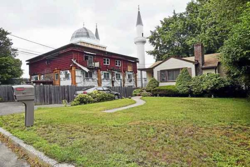 The 81-foot fiberglass minarets flank the 12,000-square-foot mosque's exterior, photographed from Weybosset Street in New Haven. Catherine Avalone / Hearst Connecticut Media