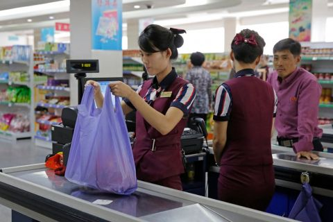 North Koreans work at a supermarket in Pyongyang.CreditCreditKin Cheung/Associated Press