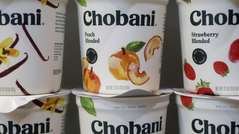 In this Monday, Nov. 20, 2017 photo, Chobani yogurt cups are displayed in New York. Chobani, the company that helped kick-start the Greek yogurt craze, is shrinking those words from its label as it hints it may expand beyond that food in an increasingly crowded yogurt market.