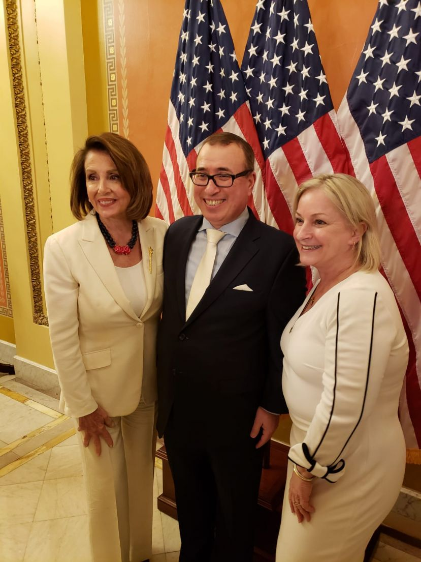 Businessman Guzel with Congresswoman Wild and Nancy Pelosi, Speaker of House.