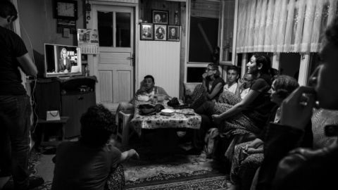 A family in Turkey watches the attempted military coup unfold on the state television network TRT on July 15, 2016. (Mustafa Can Koca)