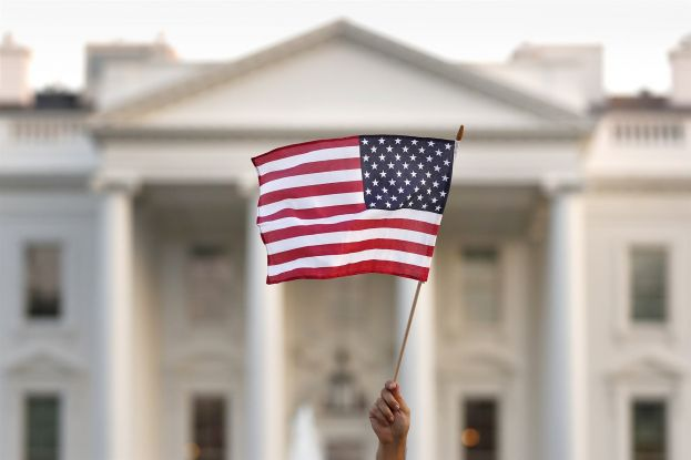 A flag is waved outside the White House in September 2017.Carolyn Kaster / AP file