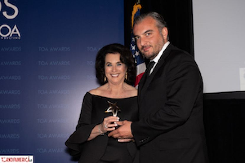 Mona Diamond receives her plaque from Barbaros Karaahmet, Partner and Co-Chair of Herrick, Feinstein.